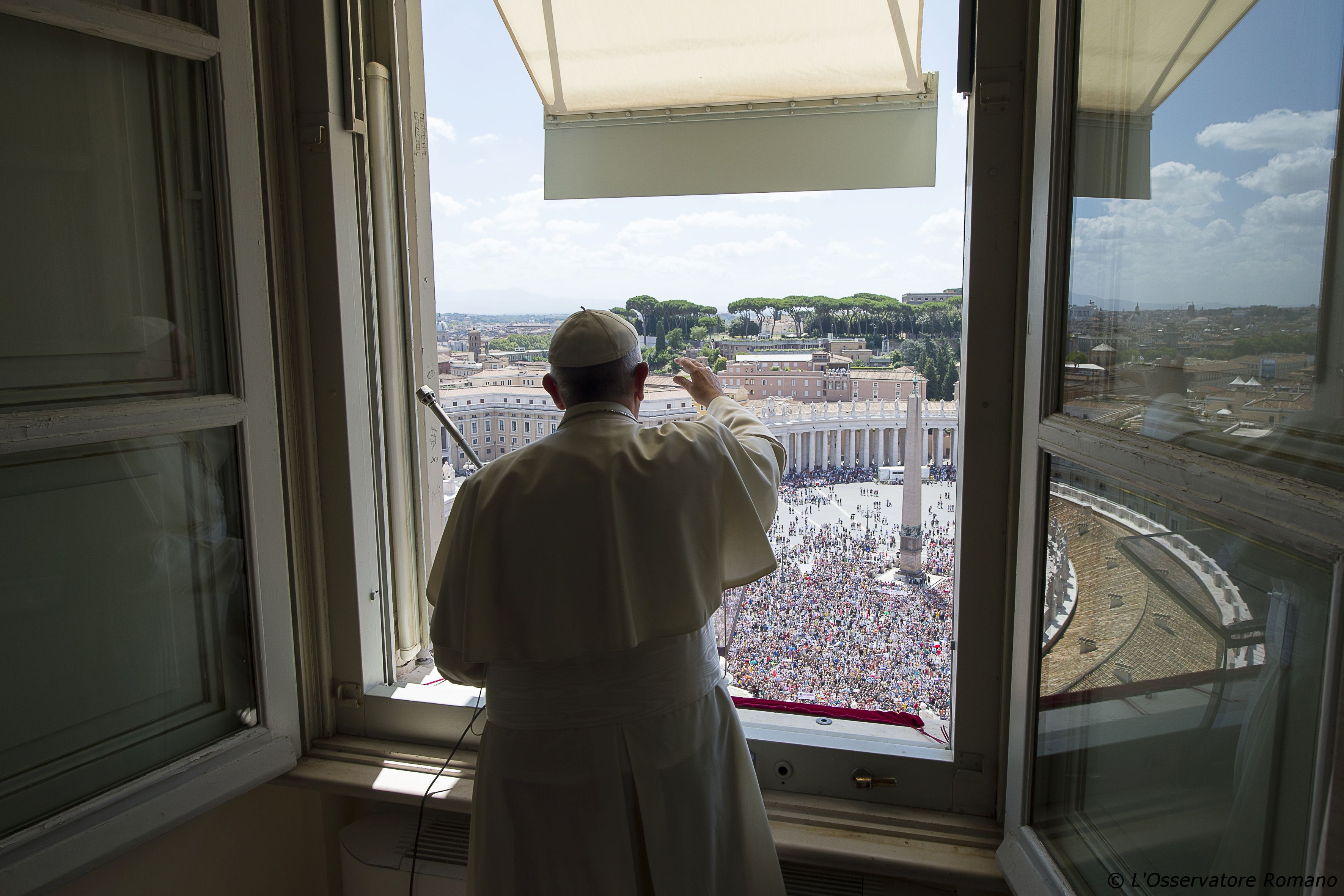 Pope Francis greets the faithful during the Angelus of Sunday 26th of July 2015