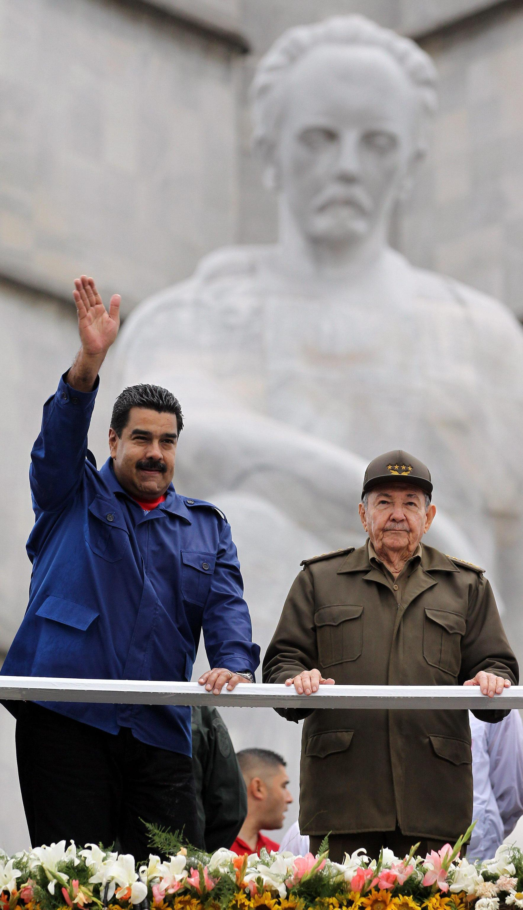 Cuban President Raul Castro (R) and his Venezuelan counterpart Nicolas Maduro (L) attend the May Day parade at the Revolution Sauqre in Havana