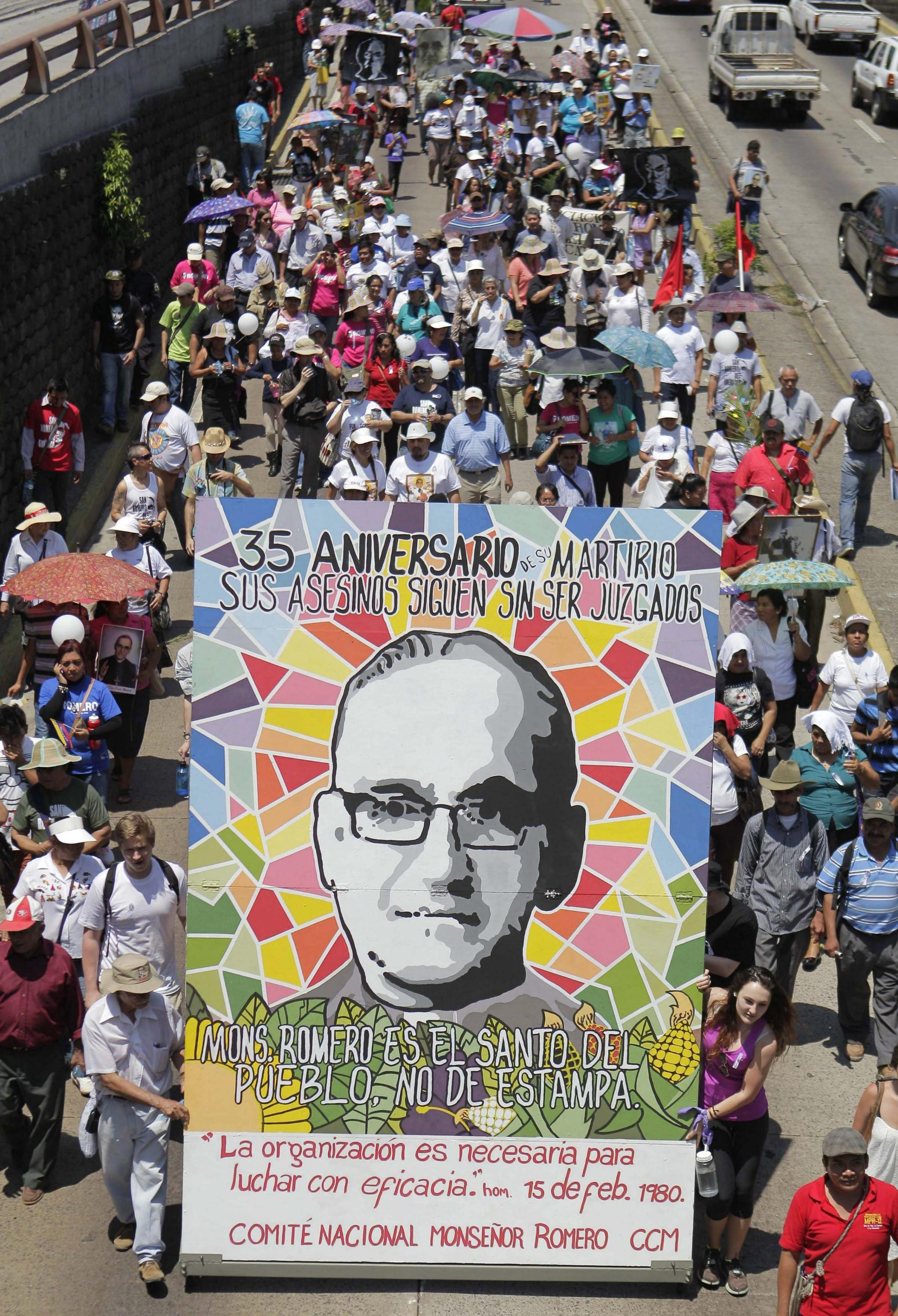 Salvadoreans take part in the march commemorating the 35th anniversary of the assassination of Archbishop Oscar Arnulfo (24th of March 1980)