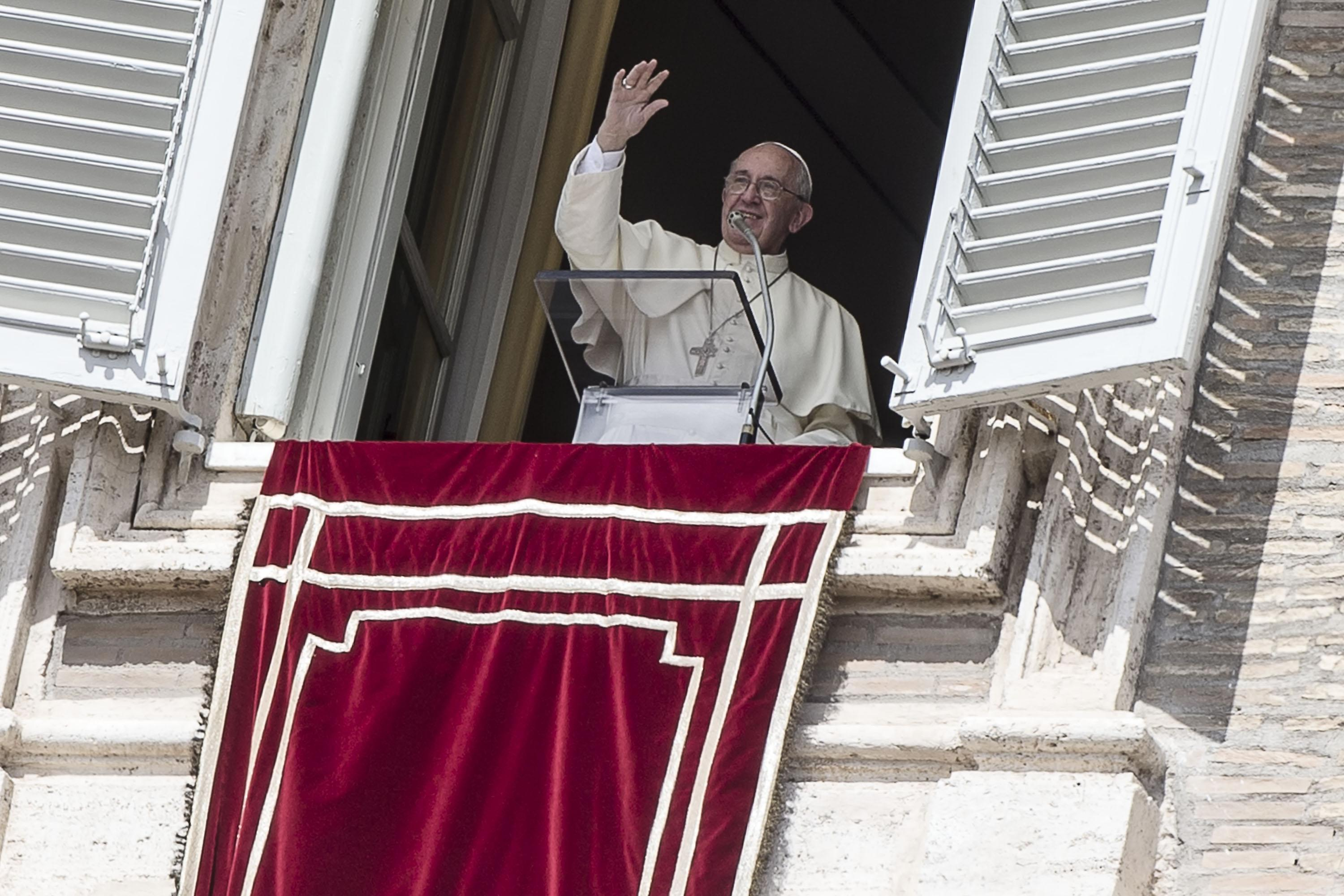 Pope Francis greets faithful during the Angelus prayer in St. Peter's Square