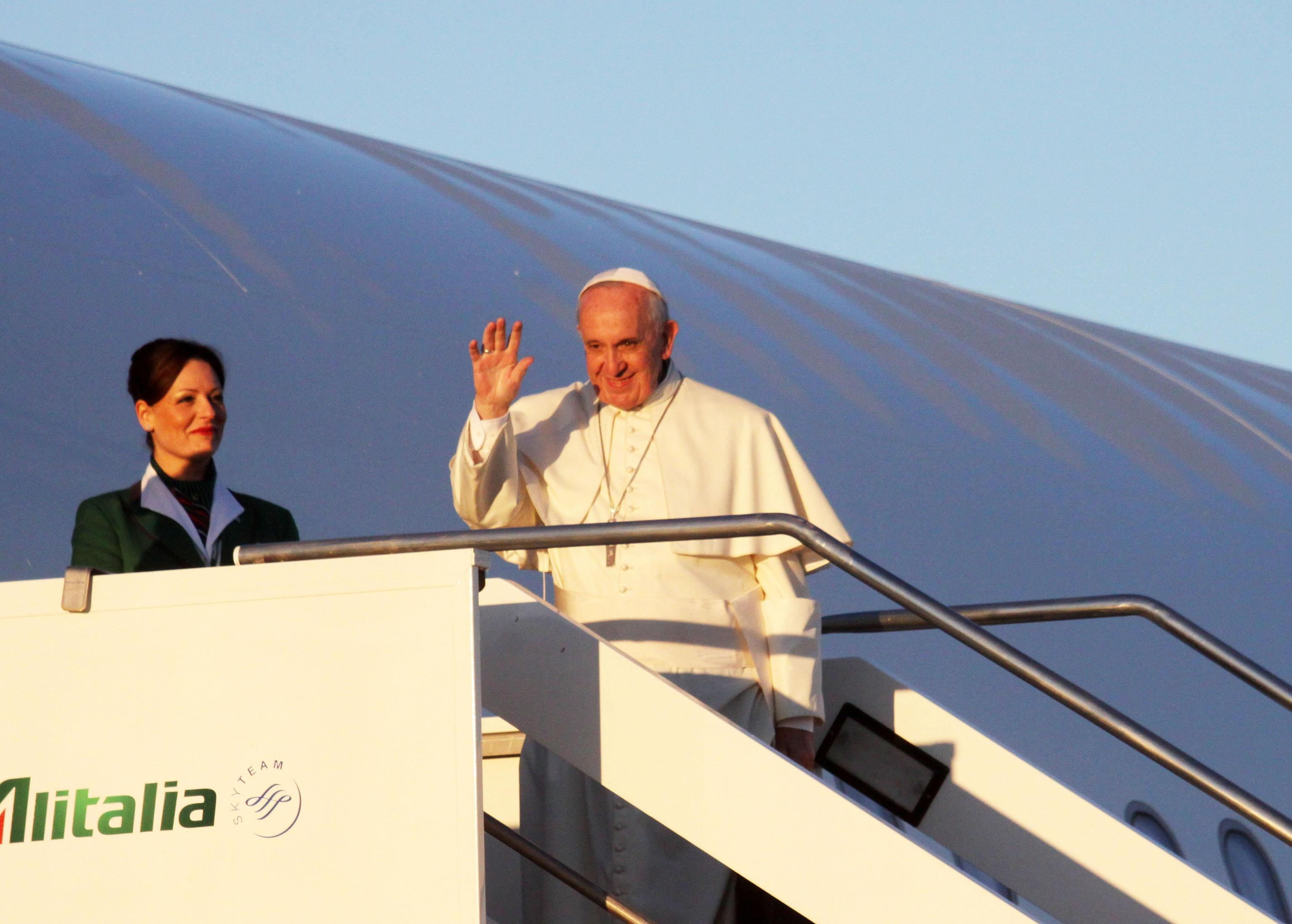 Pope Francis boards an Alitalia airplane at Rome's Fiumicino International Airport
