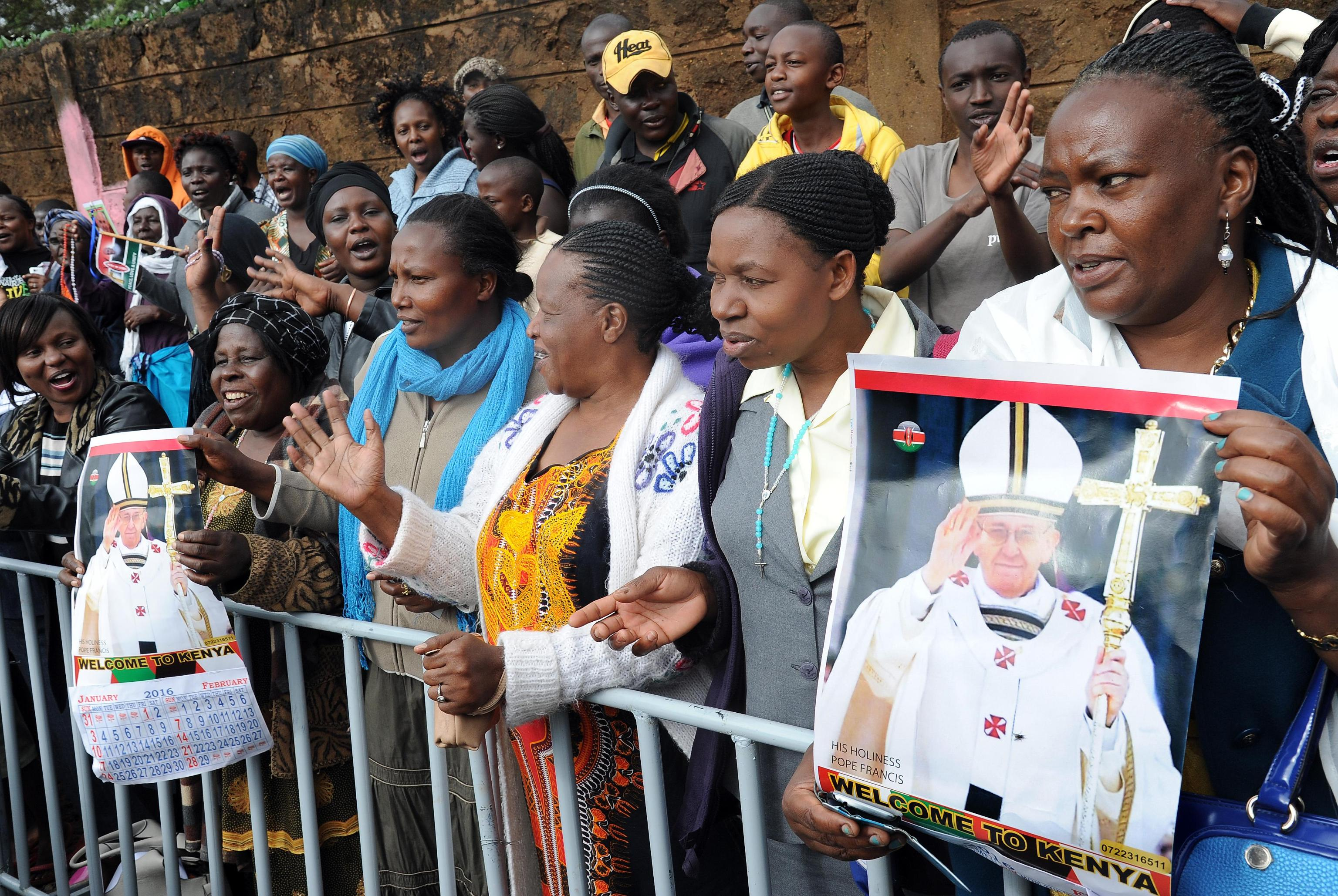 People wait for the visit of Pope Francis in the Kangemi neighborhood in Nairobi