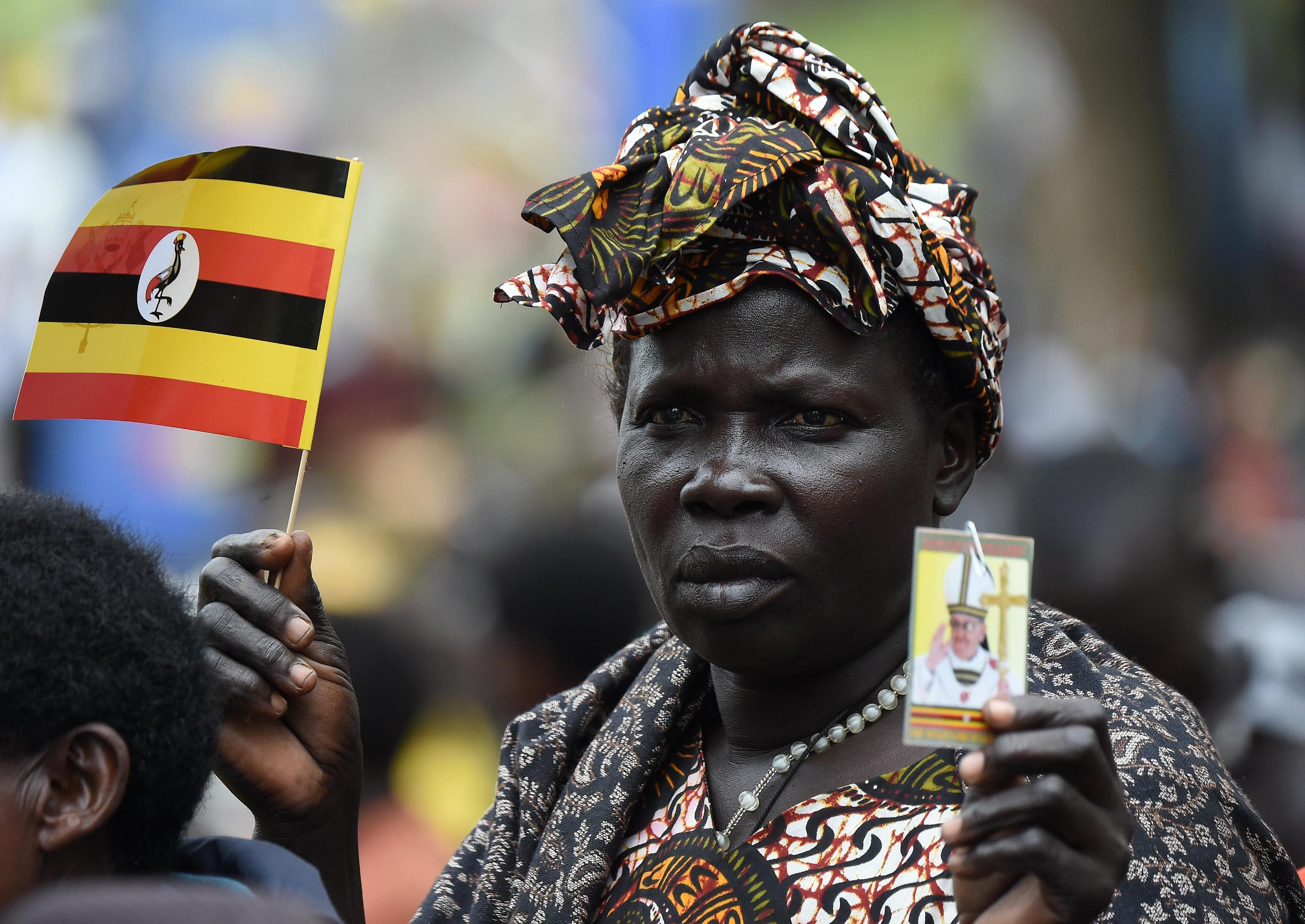 A woman attends a Mass for the martyrs of Uganda celebrated by Pope Francis near the Catholic shrine of Namugongo in Kampala