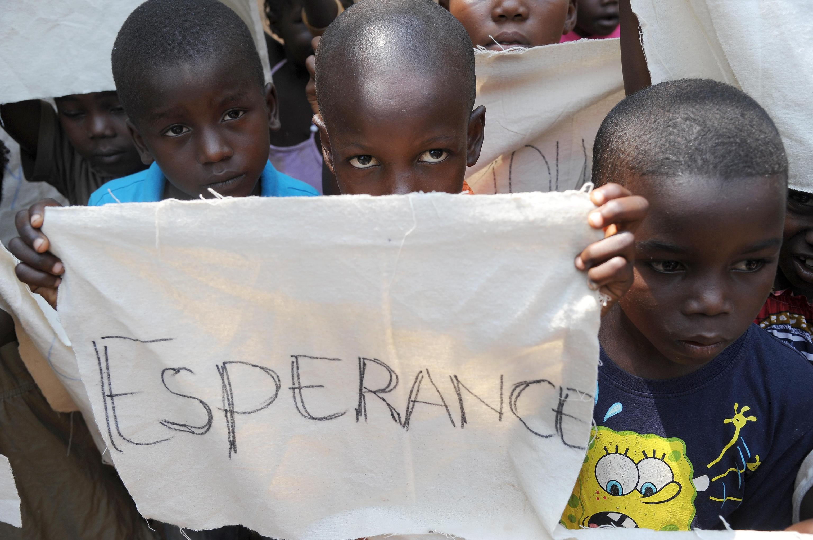 Kids wait for the arrival of Pope Francis's visit at a refugee camp in Bangui
