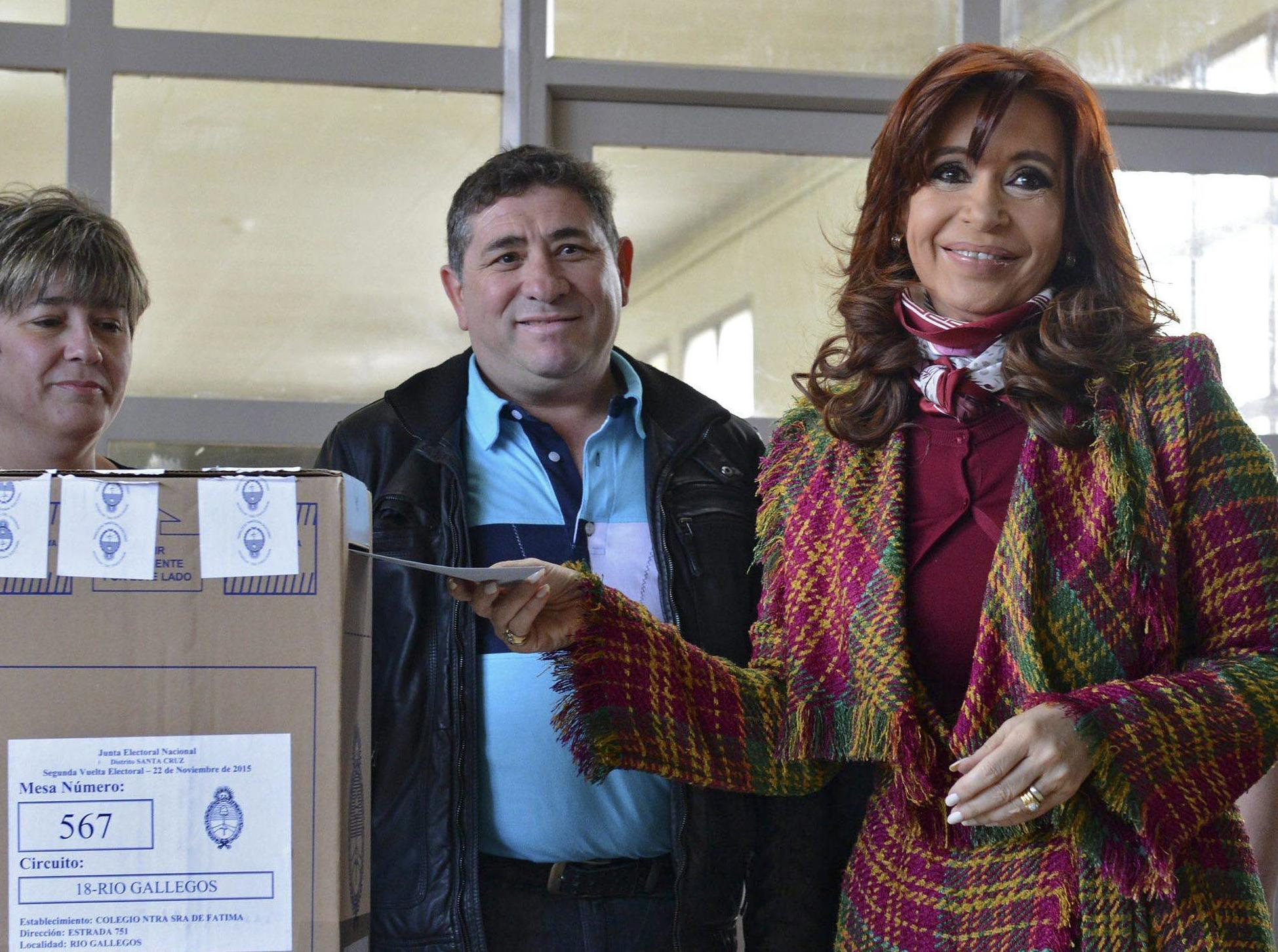 A handout picture provided by Presidency of Argentina of Argentinian President Cristina Fernandez de Kirchner (R) casting her vote as Argentina is holding its first presidential run-off election