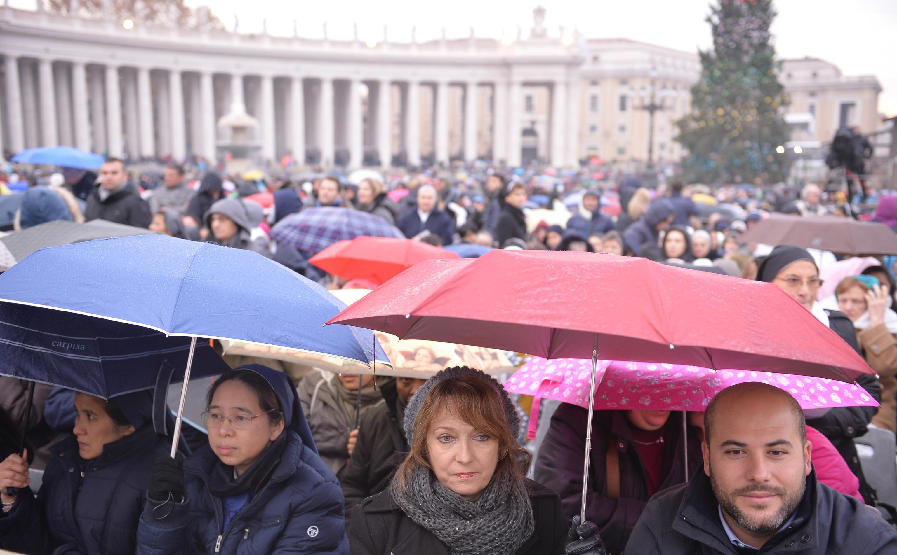 Faithful wait for the start of a mass celebrated by Pope Francis on the occasion of the opening of the Holy Door