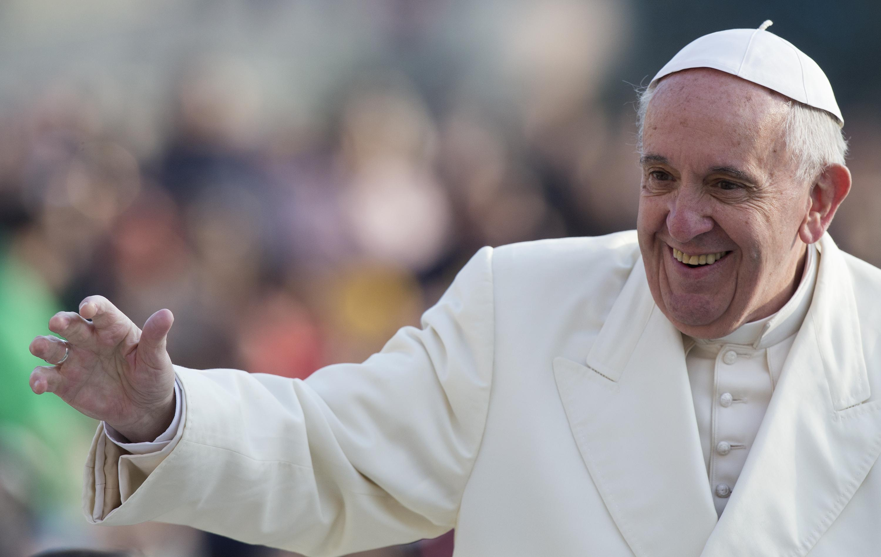 Pope Francis greets faithful at the beginning of the General audience on Wednesday 9th of December 2015