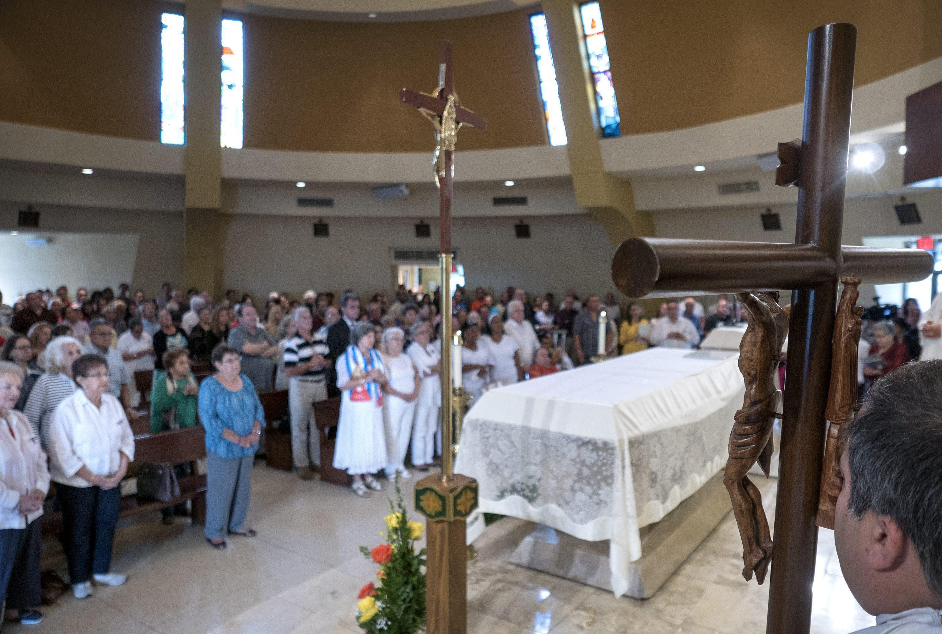People pray for the solution of the crisis of the Cuban migrants stranded in Costa Rica at the Shrine of the Virgin of Charity of el Cobre in Miami