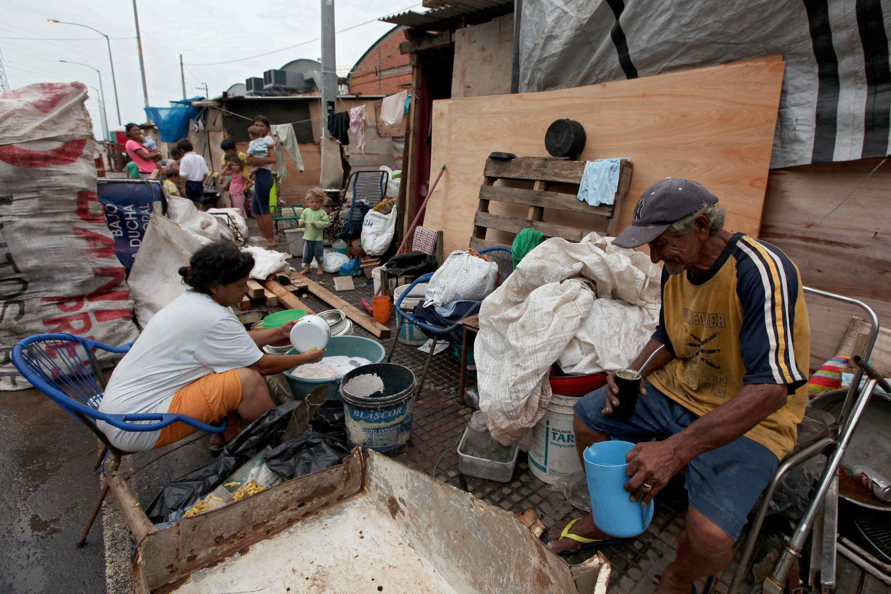 A family sits in a temporary shelter for affected people in Asuncion