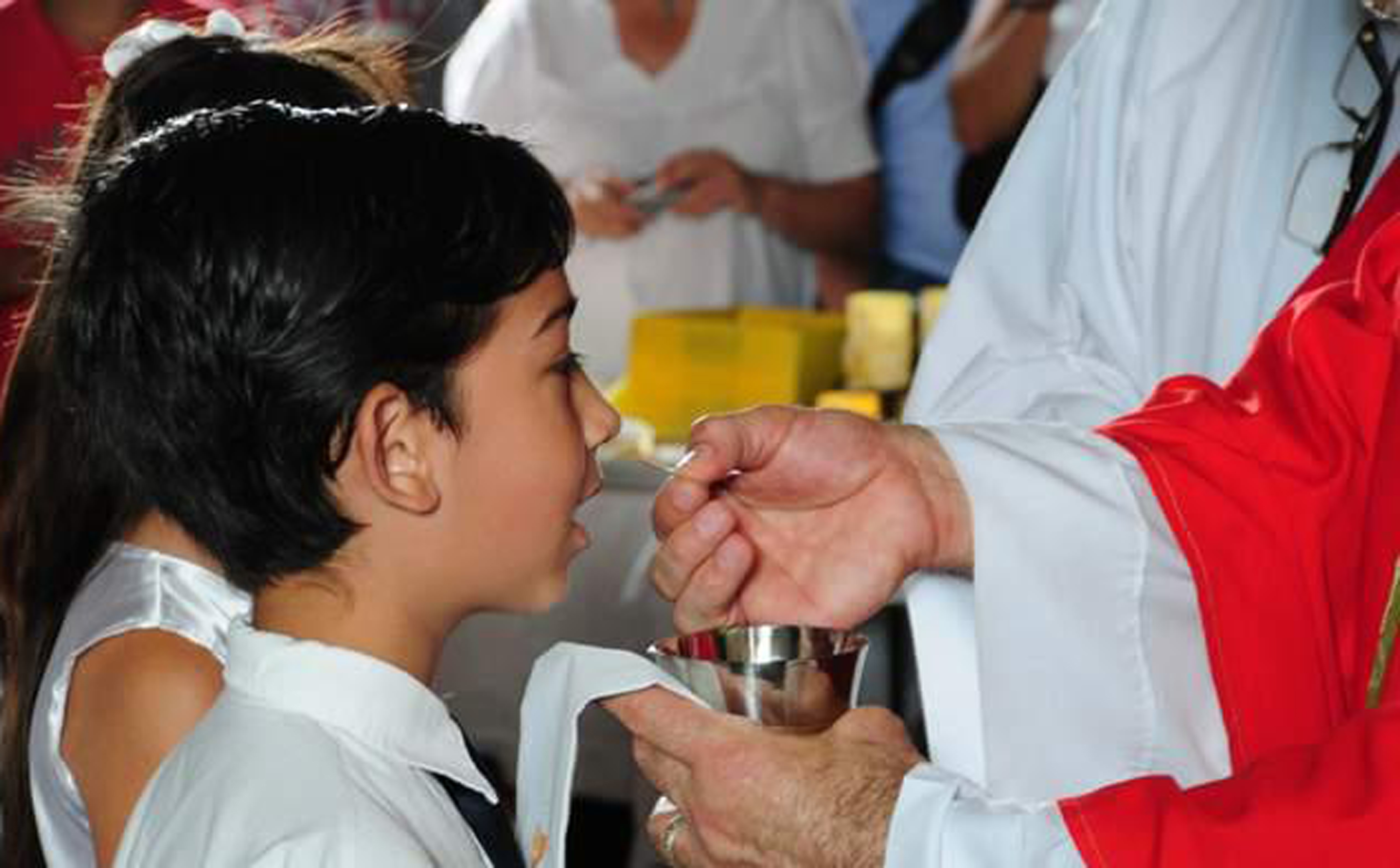 A child receiving the First Communion
