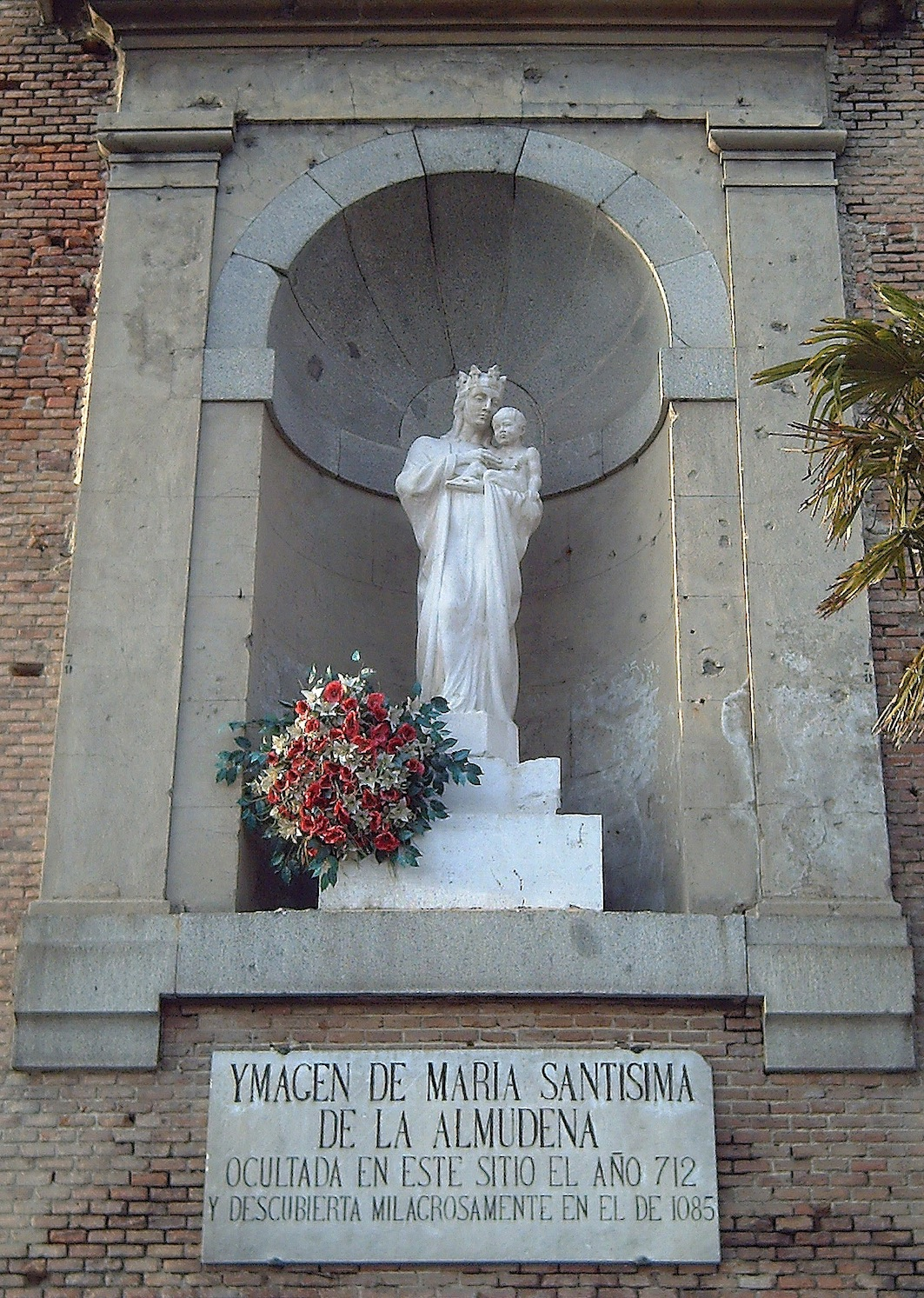 Image of the Virgin Mary on the rear wall of the Almudena Cathedral in Madrid